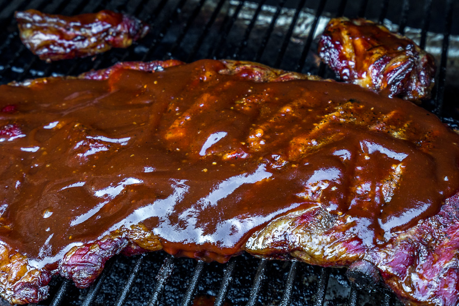 Cover smoked spare ribs in bbq sauce